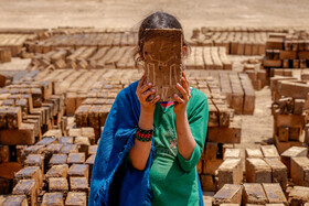 A girl is seen in a brickyard (a place where bricks are made) located in the suburbs of Qazvin, Iran, June 23, 2020.