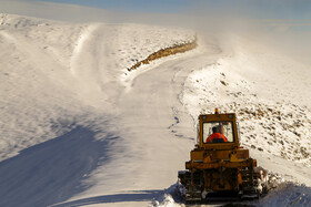 A road is reopened in Alamut District of Qazvin after heavy snow, Iran, December 10, 2020.