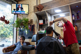 Watching the first presidential debate ahead of Iran's June 18 election, Qazvin, Iran, June 5, 2021.
